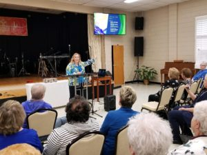 Jo Heather presenting at Women's meeting